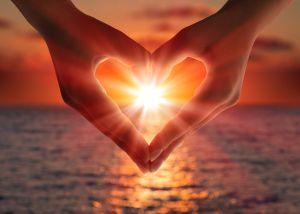 sunset in heart hands