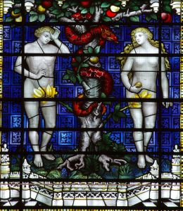 A stained glass window: Adam and Eve and the snake in paradise.