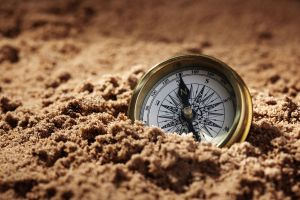 Compass in sand