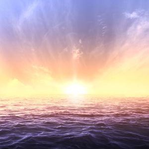 Calm sea and sky during sundown. Bright seascape background
