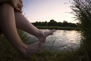 Wide Angle View of Female Legs at a River in a City Park