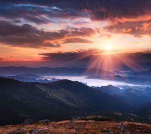 Colorful panoramic sunrise in the mountains landscape. Dramatic morning sky.